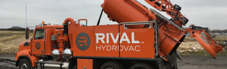 Hydraulic opens back gate and lifts tank for easy dump